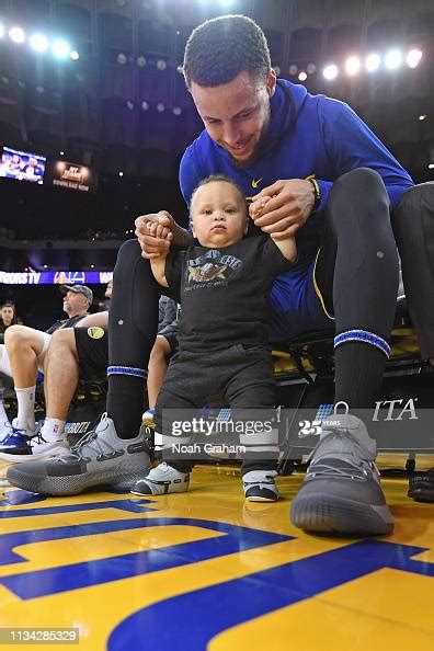 Stephen Curry of the Golden State Warriors and his son